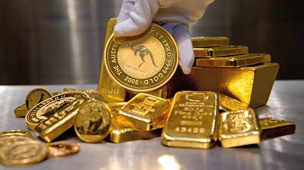 Goldbarren und Münzen
